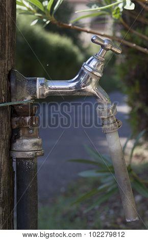 Outdoor Water Tap In A Garden