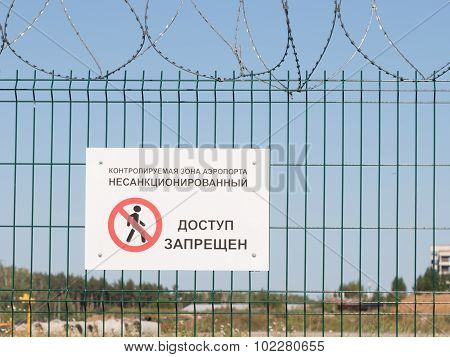Warning Sign On The Fence Airport