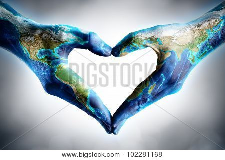 earth's day celebration - hands shaped heart with world map