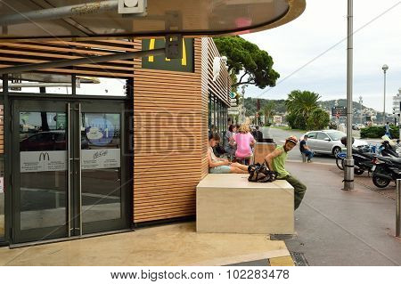 NICE, FRANCE - AUGUST 15, 2015: McDonald's restaurant exterior. McDonald's is the world's largest chain of hamburger fast food restaurants, founded in the United States.
