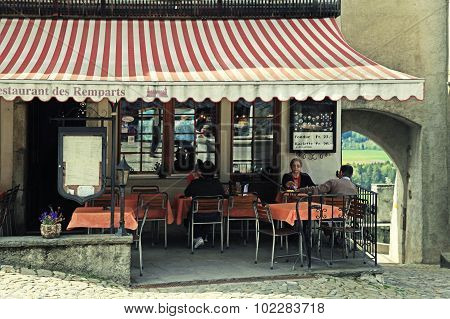 Traditional Cafe In The Swiss Village Gruyeres, Switzerland