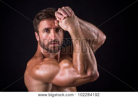 Serious shirtless mascular man
