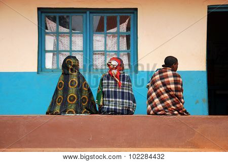 Three Women Looking Forward To The Visit To The Dispensary Of The Village Pomerini In Tanzania, Afri