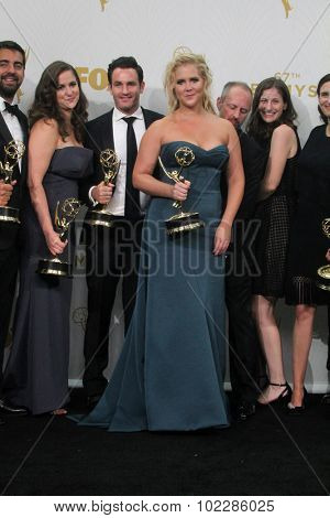 LOS ANGELES - SEP 20:  Amy Schumer at the Primetime Emmy Awards Press Room at the Microsoft Theater on September 20, 2015 in Los Angeles, CA