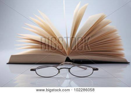 book and a pair of spectacle