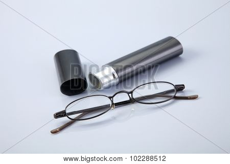 reading glass with gray container