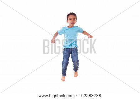 Portrait Of A Cute Little African American Boy Jumping On A Trampoline