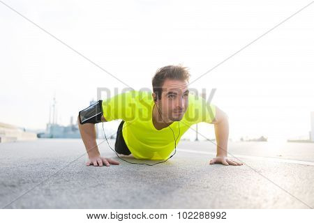 Young caucasian male jogger warm up before start his workout training outside in morning