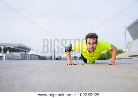 Caucasian male jogger warm up before start his workout training outside in morning