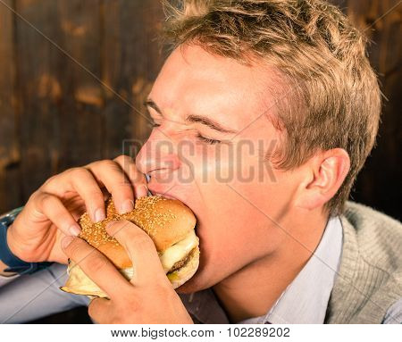Handsome Man Eating Cheeseburger
