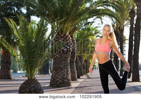 Fit woman with perfect body working outdoors copy space area