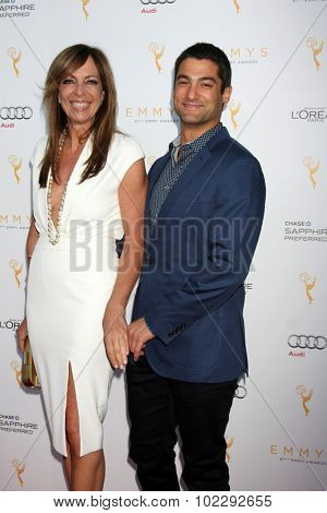 LOS ANGELES - SEP 19:  Allison Janney, Philip Joncas at the 67th Emmy Awards Performers Nominee Reception at the Pacific Design Center on September 19, 2015 in West Hollywood, CA