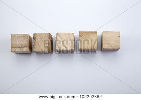 Five wood blocks in the white background.