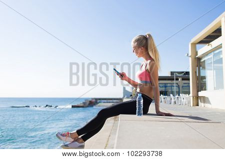 Fit women relaxing after morning run in the fresh air