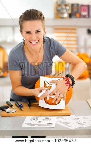 Funny Woman Creating Pumpkin Jack-o-lanter For Halloween Party