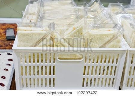 Cut Platter Of Sandwich Triangles In Plastic Box Ready For Sell