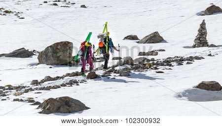 Free-riders ski climbers at the mountain summit in scenic Tian Shan range in Kyrgyzstan, Ala-Archa national park