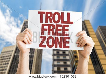 Troll Free Zone placard with skyscrappers background