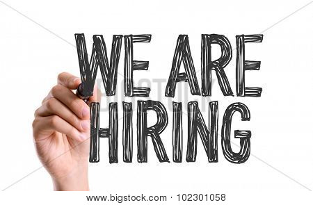 Hand with marker writing: We Are Hiring