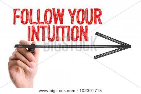 Hand with marker writing: Follow Your Intuition