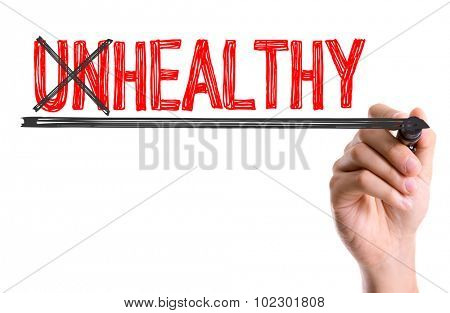Hand with marker writing: Unhealthy/Healthy