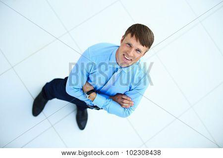 Portrait of a handsome elderly business man standing indoor
