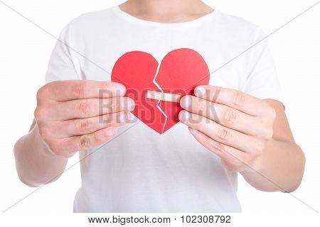 Young Man Holding Broken Heart With Plaster