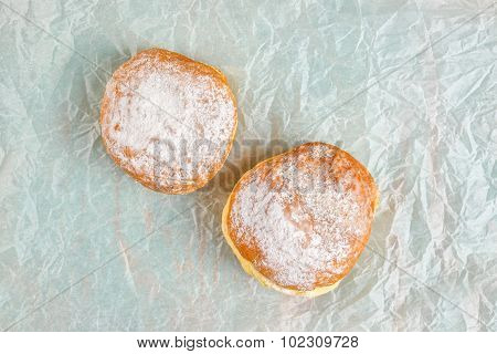 Sweet Sugary Donuts On Baking Paper