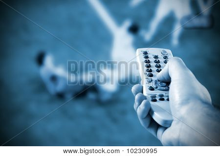 Male Hand Holding A Remote Control