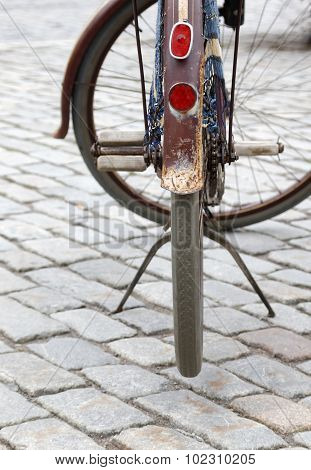 Close Up Of The Wheel Of An Old Bicyce