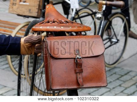 Closeup Of Leather Case And Saddle On Antique Bicycle