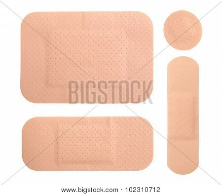 Different Medical Adhesive Plasters Isolated On White