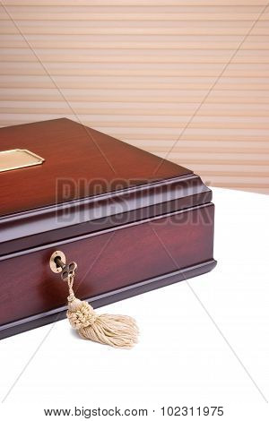 Beautiful wooden box with a metal key