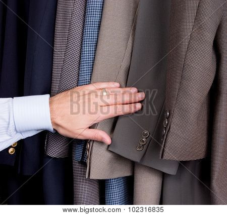 Man searching through suits