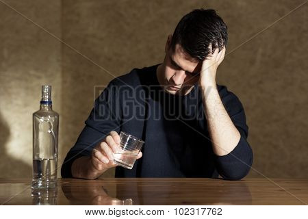Young Man Drinking Vodka
