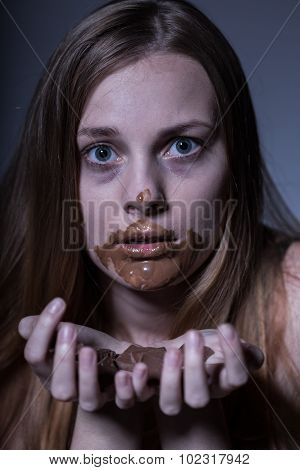 Teenager Gorging On Chocolate