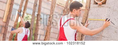 Builders Working On Construction Site