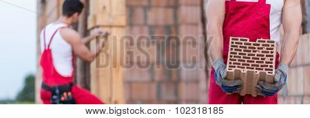 Construction Worker With Brick