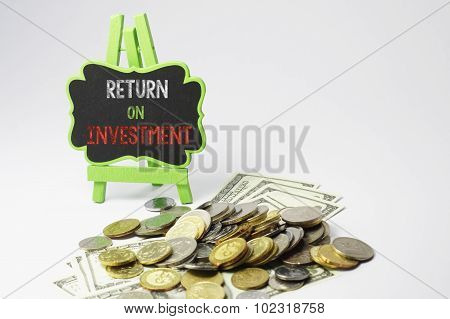 Return On Investment Text And Money - Business Concept