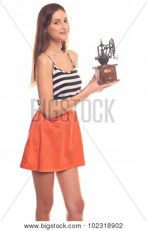 Woman isolated on a white background holding hands in a mechanical grinder