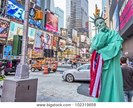 NEW YORK, USA - Sept 18th, 2015: Street performer dressed as Statue of Liberty in New York's busy Times Square