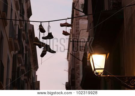 Dirty Sneakers Hanging On The Clothesline Silhouette