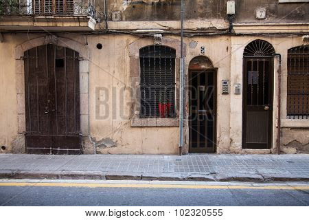Antique Door And Old Wall In The Street.