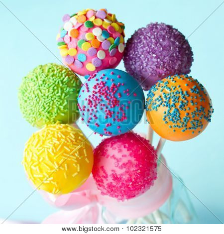 Colorful cake pops tied with a ribbon