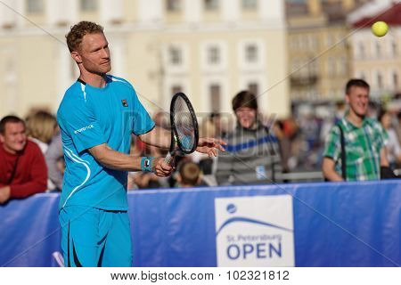 ST. PETERSBURG, RUSSIA - SEPTEMBER 12, 2015: Professional tennis player Dmitry Tursunov in the exhibition match of St. Petersburg Open. The match included in the program of the City's Tennis Day.