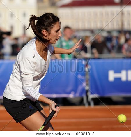 ST. PETERSBURG, RUSSIA - SEPTEMBER 12, 2015: Former professional tennis player Anastasia Myskina in the exhibition match of St. Petersburg Open. The match included in the program of City's Tennis Day.
