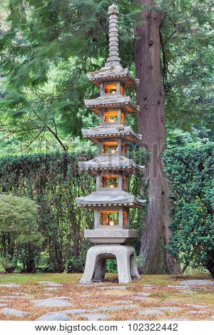 Tall Stone Lantern At Japanese Garden
