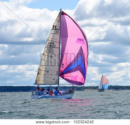 sailboat race with colorful spinnaker