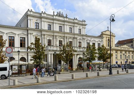 WARSAW, POLAND - SEPTEMBER 16, 2015: Old Resursy Civic Building, now the Polonia House at Krakowskie Przedmiescie Street on 16 September 2015 in Warsaw, Poland. It was built in the years 1860-1861.