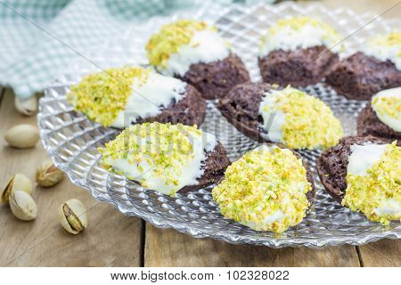 Dark Chocolate Madeleines Covered With White Chocolate And Pistachio